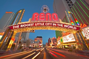 "March 2004, Reno, Nevada, USA --- A huge neon sign on an arch declares Reno to be ""the biggest little city in the world."" --- Image by © Owaki - Kulla/CORBIS"