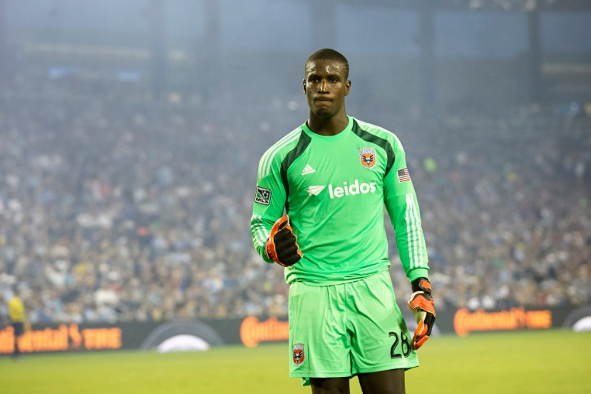 Aug 23, 2014; Kansas City, KS, USA; D.C. United goalkeeper Bill Hamid (28) celebrates D.C. United's second goal during the match between D.C. United vs Sporting KC at Sporting Park. The final score of the match was D.C. United 3 Sporting KC 0.Mandatory Credit: Gary Rohman/Sporting KC-USA TODAY Sports