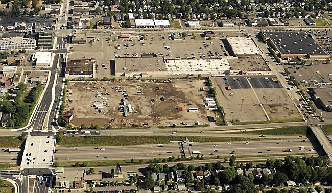 An August 2015 aerial view shows the former Metro Transit bus barn site, possible home of a major league soccer stadium. At left is Snelling Avenue; Interstate 94 is in the foreground. A strip mall and parking lot separate the site from University Avenue, at the top of the photo. (Pioneer Press: Scott Takushi)